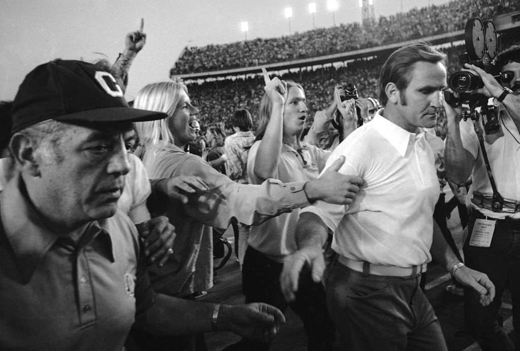 . Cleveland Browns coach Nick Skorich, left, and Miami Dolphins coach Don Shula walk amongst the rejoicing Miami Dolphins fans in Miami on Dec. 24, 1972 after Miami Dolphins defeated Cleveland Browns 20-14, Shula the winner. (AP Photo)