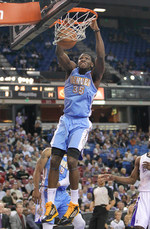 . Denver Nuggets forward Kenneth Faried, hangs from the rim after a dunk against the Sacramento Kings during the first quarter of an NBA basketball game in Sacramento, Calif., Tuesday, March 5, 2013. (AP Photo/Rich Pedroncelli)