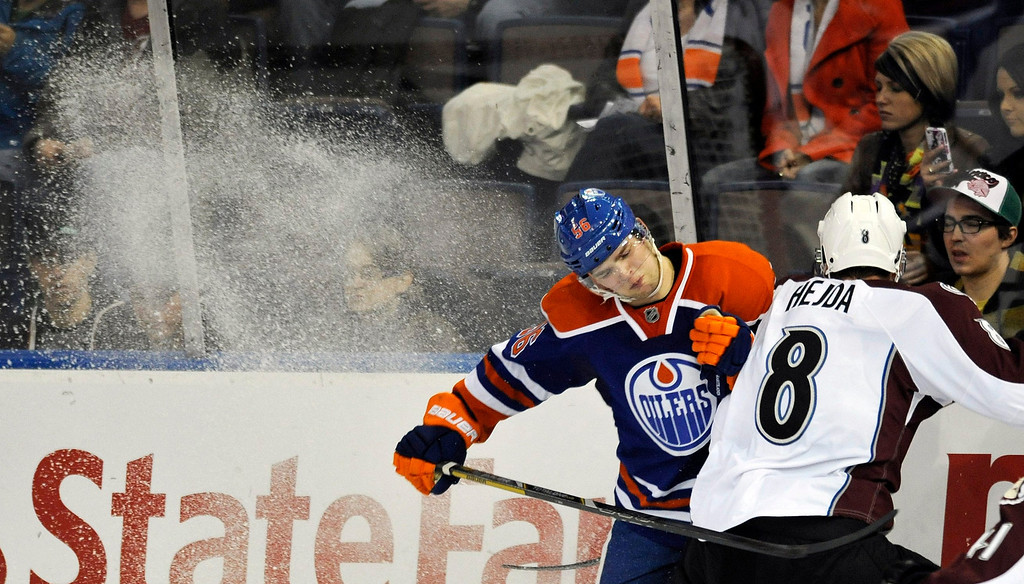 . Edmonton Oilers\' Teemu Hartikainen (L) and Colorado Avalanche\'s Jan Hejda collide during the second period of their NHL hockey game in Edmonton February 16, 2013. REUTERS/Dan Riedlhuber