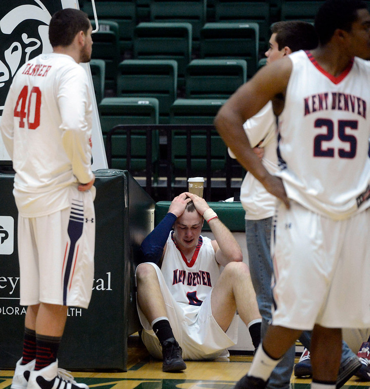 . FT. COLLINS, CO. - MARCH 16TH: Brian Boatman, Kent Denver High School, center, dejected after losing to Pagosa Springs, 53-49 in the 3A Boys Colorado State Championship game at Moby Arena in Ft. Collins Saturday evening. Boatman missed two free throws very late in the fourth quarter. (Photo By Andy Cross/The Denver Post)