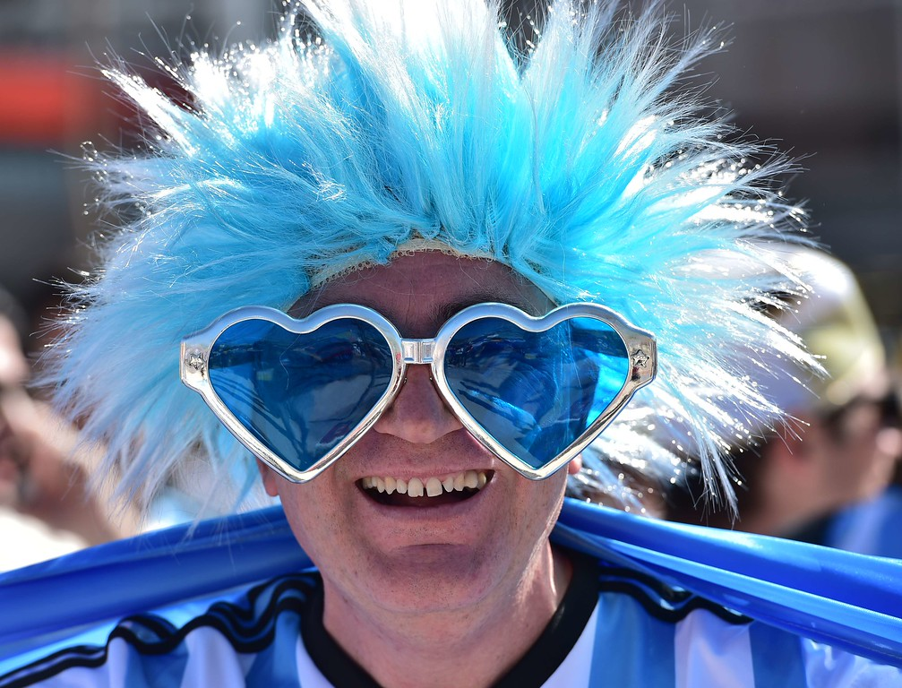 . An Argentinian supporter poses ahead of the Round of 16 football match between Argentina and Switzerland outside The Corinthians Arena in Sao Paulo on July 1, 2014, during the 2014 FIFA World Cup. AFP PHOTO / NELSON ALMEIDA/AFP/Getty Images