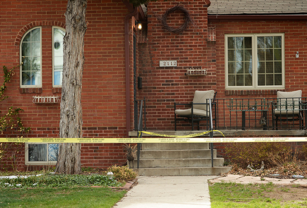 . Denver police investigate a homicide at a home in the 2100 block of South Saint Paul Street in Denver, Tuesday, April 15, 2014. A woman was found dead in a home near the University of Denver Monday night. (Photo by RJ Sangosti/The Denver Post)
