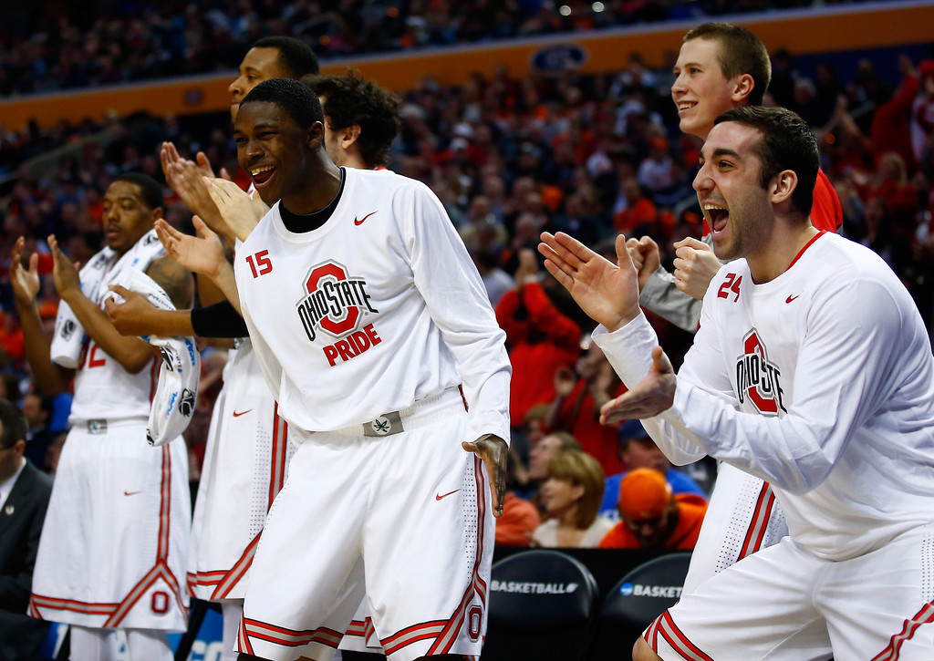 . Andrew Goldstein #24 and Kam Williams #15 of the Ohio State Buckeyes react after a play against the Dayton Flyers during the second round of the 2014 NCAA Men\'s Basketball Tournament at the First Niagara Center on March 20, 2014 in Buffalo, New York.  (Photo by Jared Wickerham/Getty Images)