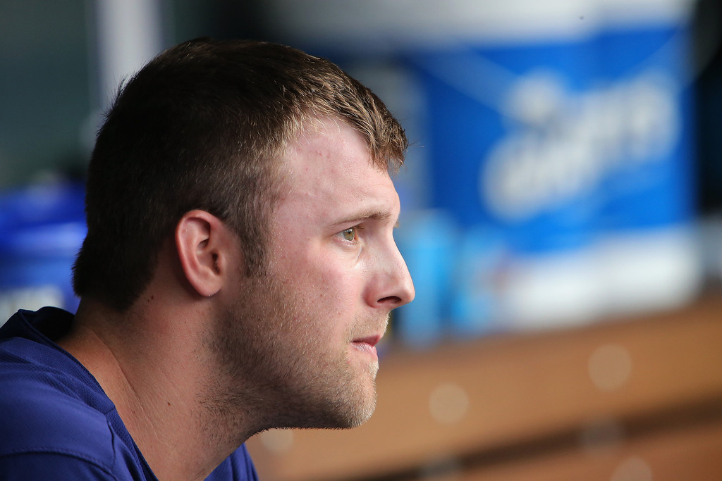 . Starting pitcher Jordan Lyles #24 of the Colorado Rockies looks on from the dugout as he works against the Texas Rangers during Interleague play at Coors Field on May 5, 2014 in Denver, Colorado.  (Photo by Doug Pensinger/Getty Images)