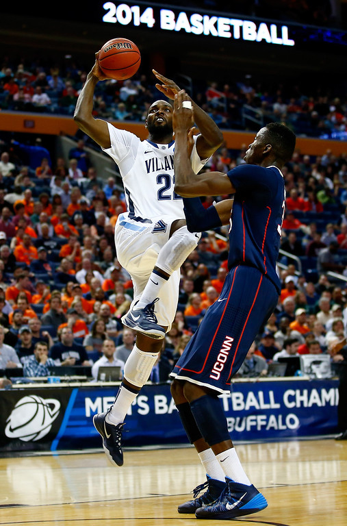 . BUFFALO, NY - MARCH 22: JayVaughn Pinkston #22 of the Villanova Wildcats goes up for a shot as Amida Brimah #35 of the Connecticut Huskies defends during the third round of the 2014 NCAA Men\'s Basketball Tournament at the First Niagara Center on March 22, 2014 in Buffalo, New York.  (Photo by Jared Wickerham/Getty Images)