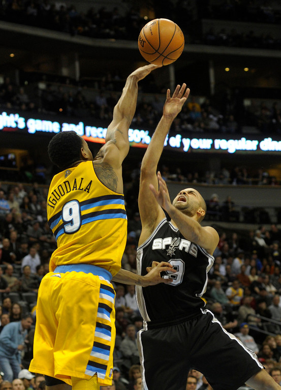 . Denver forward Andre Iguodala (9) blocked a shot by Spurs guard Tony Parker (9) in the first half. The Denver Nuggets hosted the San Antonio Spurs at the Pepsi Center Tuesday night, December 18, 2012. Karl Gehring/The Denver Post