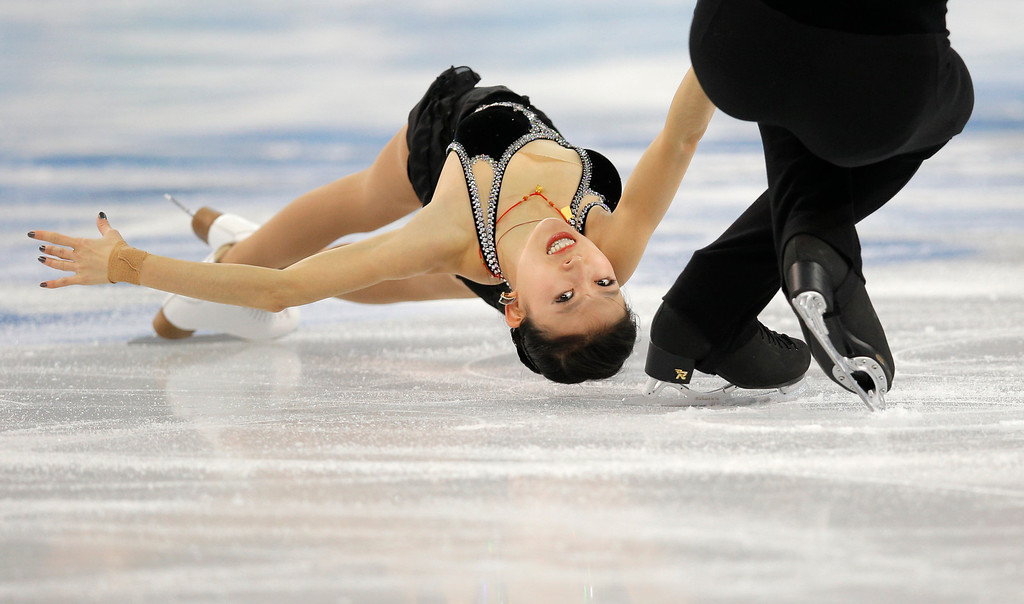 Description of . Pang Qing and Tong Jian of China compete in the pairs short program figure skating competition at the Iceberg Skating Palace during the 2014 Winter Olympics, Tuesday, Feb. 11, 2014, in Sochi, Russia. (AP Photo/Vadim Ghirda)