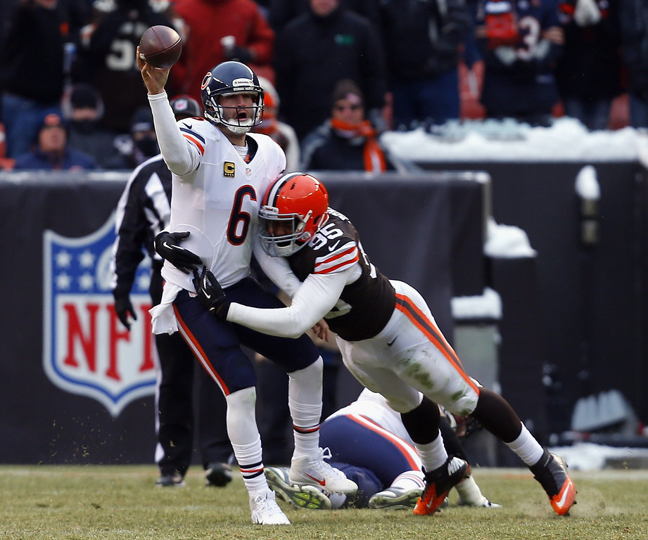 . Quarterback Jay Cutler #6 of the Chicago Bears throws to a receiver as he is hit by defensive lineman Armonty Bryant #95 the Cleveland Browns at FirstEnergy Stadium on December 15, 2013 in Cleveland, Ohio.  (Photo by Matt Sullivan/Getty Images)