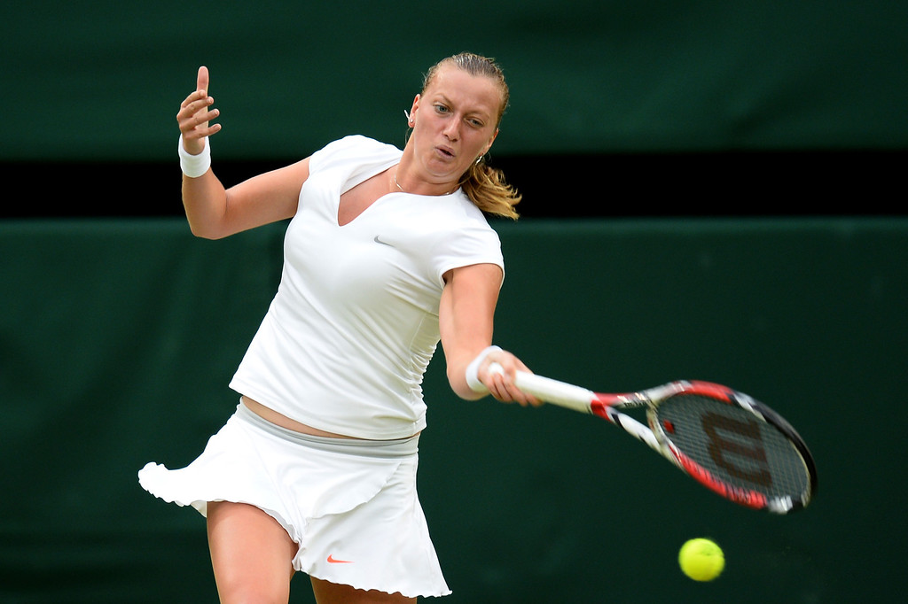 . LONDON, ENGLAND - JULY 02:  Petra Kvitova of Czech Republic plays a forehand during the Ladies\' Singles quarter-final match against Kirsten Flipkens of Belgium on day eight of the Wimbledon Lawn Tennis Championships at the All England Lawn Tennis and Croquet Club at Wimbledon on July 2, 2013 in London, England.  (Photo by Mike Hewitt/Getty Images)