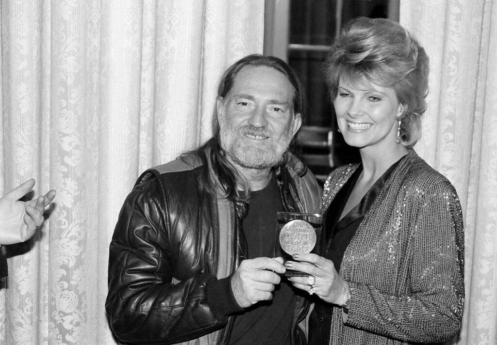. Willie Nelson, country singer and musician, poses with his wife, Connie, after receiving the Lifetime Achievement Award at the Songwriter\'s Hall of Fame Awards ceremony in New York City, March 7, 1983.  (AP Photo)