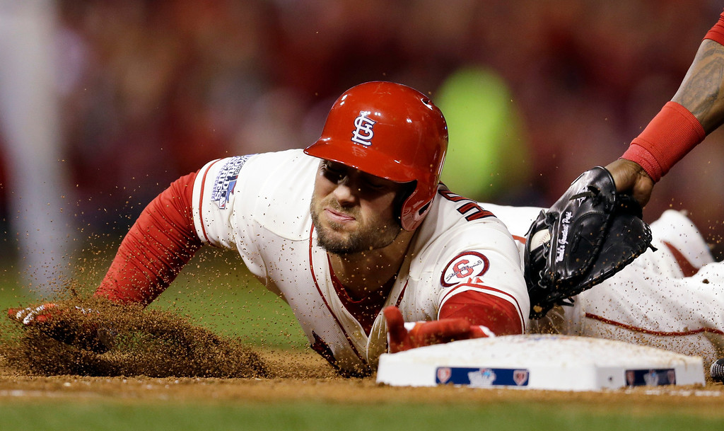 . St. Louis Cardinals\' Matt Holliday is tagged out at first during the third inning of Game 3 of baseball\'s World Series against the Boston Red Sox Saturday, Oct. 26, 2013, in St. Louis. Holliday rounded first on a dropped ball and was thrown out. (AP Photo/Jeff Roberson)