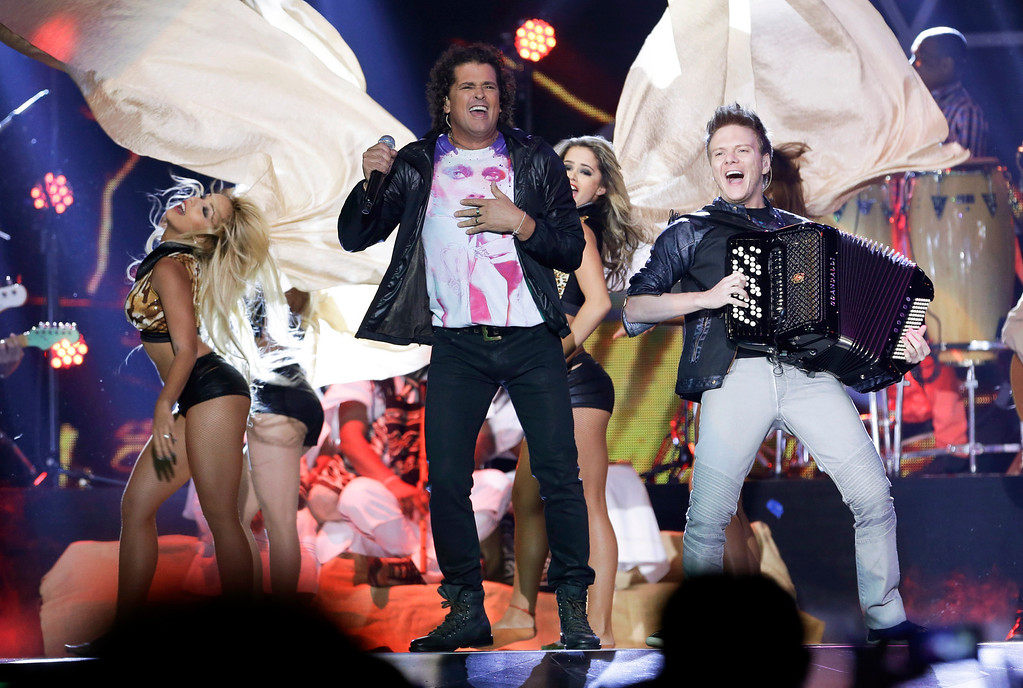 . Singer Carlos Vives performs at the Latin Billboard Awards in Coral Gables, Fla., Thursday April 25, 2013. (AP Photo/Alan Diaz)