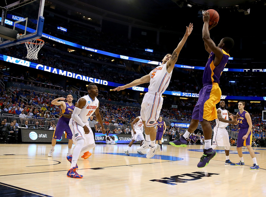 . ORLANDO, FL - MARCH 20:  DJ Evans #3 of the Albany Great Danes shoots over Scottie Wilbekin #5 of the Florida Gators in the first half during the second round of the 2014 NCAA Men\'s Basketball Tournament at Amway Center on March 20, 2014 in Orlando, Florida.  (Photo by Mike Ehrmann/Getty Images)