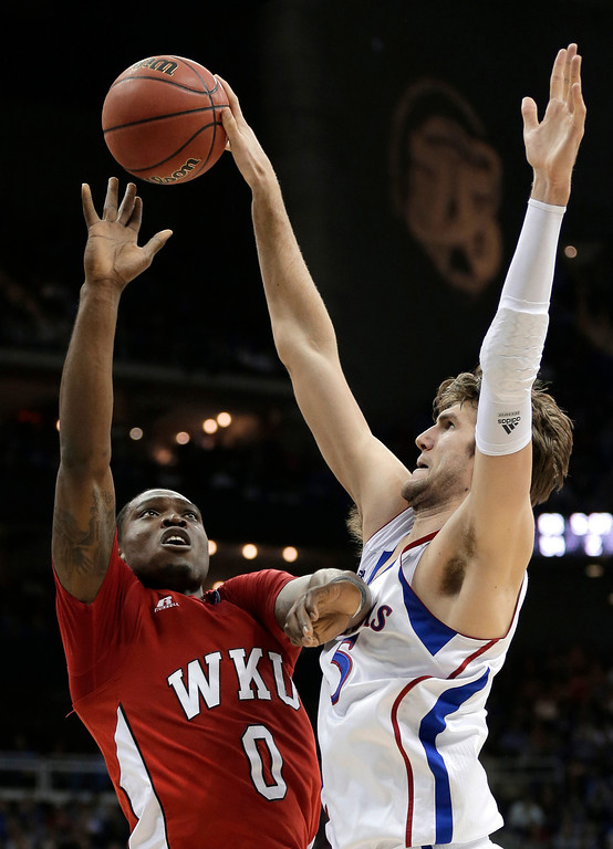 . Kansas center Jeff Withey (5) blocks a shot by Western Kentucky forward Kene Anyigbo (0) during the first half of a second-round game of the NCAA men\'s college basketball tournament Friday, March 22, 2013, in Kansas City, Mo. (AP Photo/Charlie Riedel)