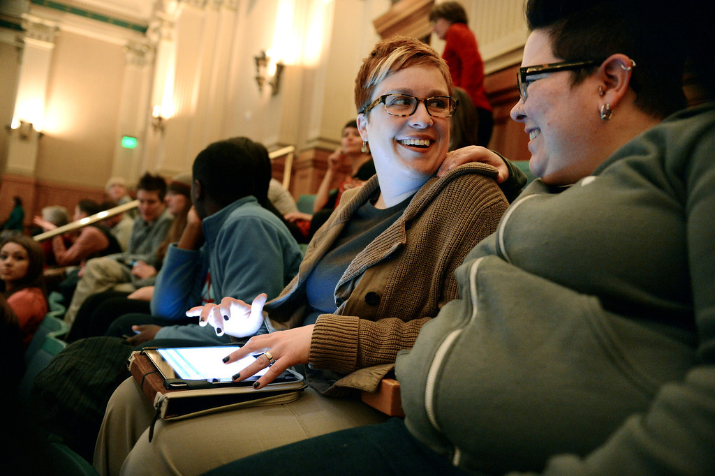 . (l-r) Stephanie Huston, left, and her partner Robyn Henderson-Espinoza share a laugh while waiting for a vote  on civil union in the State Capitol in Denver, CO March 12, 2013.  (Photo By Craig F. Walker/The Denver Post)