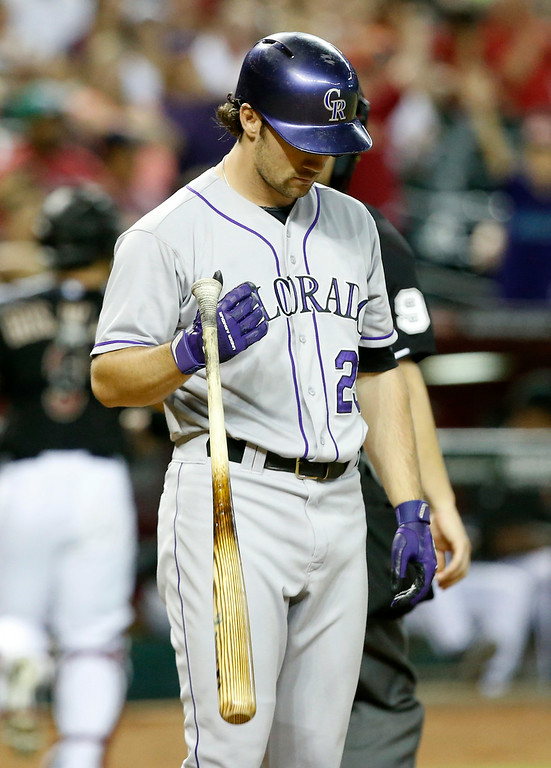 . Colorado Rockies\' Charlie Culberson tosses his bat after a sixth inning strike out against the Arizona Diamondbacks during a baseball game, Saturday, Aug. 9, 2014, in Phoenix. (AP Photo/Darryl Webb)