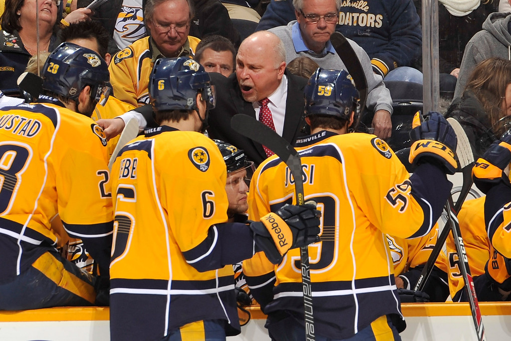 . NASHVILLE, TN - JANUARY 18:  Head coach Barry Trotz of the Nashville Predators coaches his team during a timeout against the Colorado Avalanche at Bridgestone Arena on January 18, 2014 in Nashville, Tennessee.  (Photo by Frederick Breedon/Getty Images)