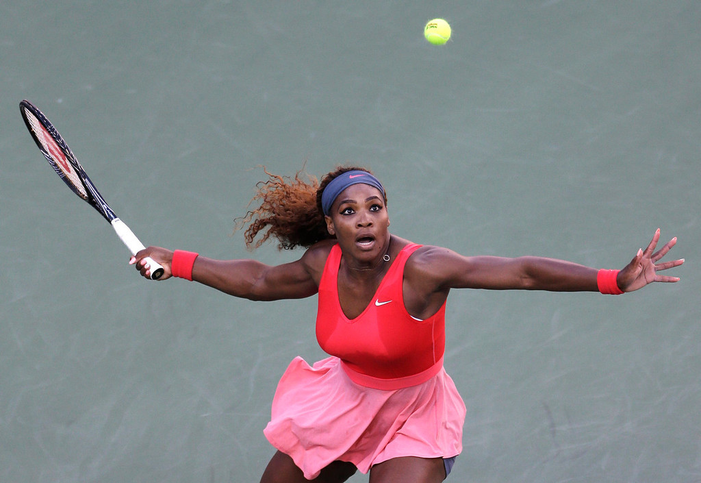 . Serena Williams returns a shot to Victoria Azarenka, of Belarus, during the women\'s singles final of the 2013 U.S. Open tennis tournament, Sunday, Sept. 8, 2013, in New York. (AP Photo/Mike Groll)