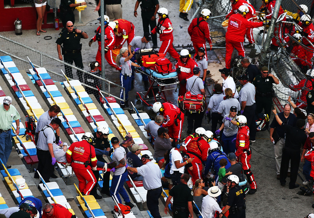 . DAYTONA BEACH, FL - FEBRUARY 23:  Medical personnel tend to fans sitting close to the wall following an incident at the finish of the NASCAR Nationwide Series DRIVE4COPD 300 at Daytona International Speedway on February 23, 2013 in Daytona Beach, Florida.  (Photo by Jonathan Ferrey/Getty Images)