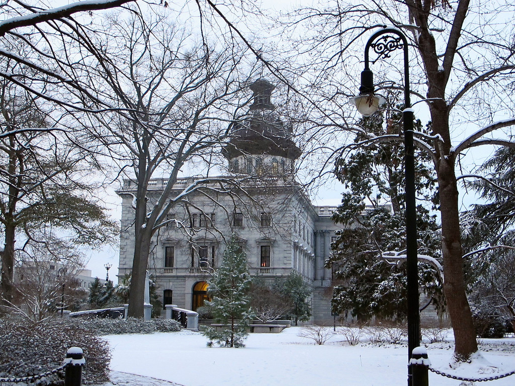 . The South Carolina Statehouse and grounds are blanketed in snow in Columbia, S.C., on Wednesday, Jan. 29, 2014 after an infrequent  snowstorm moved through the area. The Columbia area received two to three inches of snow from the storm that closed schools, government offices and businesses. (AP Photo/Bruce Smith)
