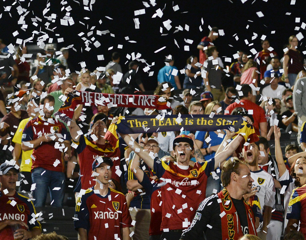 . COMMERCE CITY, CO - AUGUST 2: Salt Lake fans celebrated the win Saturday night. Real Salt Lake defeated the Colorado Rapids 1-0 at Dick\'s Sporting Goods Park Saturday night, August 2, 2014.  Photo by Karl Gehring/The Denver Post