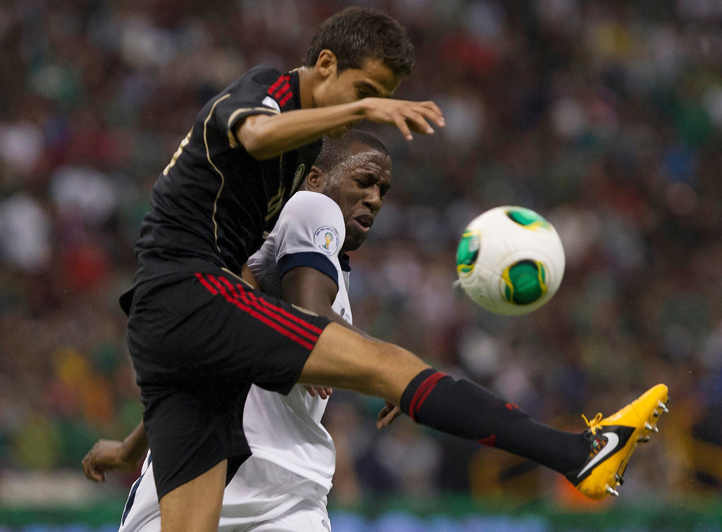. Diego Reyes (#16) of Mexico fights for the ball with Josmer Altidore (#17) of the United States during a match between Mexico and US as part of FIFA 2014 World Cup Qualifier at The Azteca stadium on March 26, 2013 in Mexico City, Mexico. (Photo by Miguel Tovar/Getty Images)