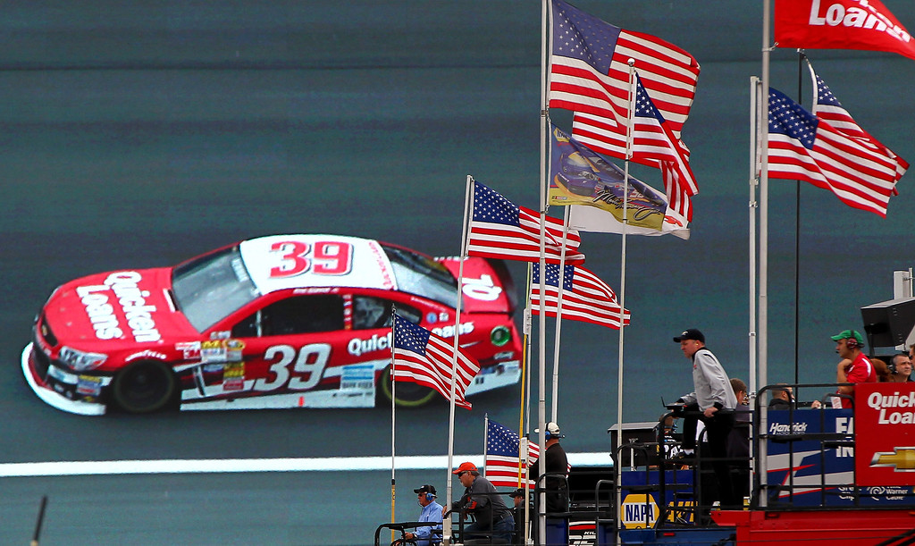 . CONCORD, NC - OCTOBER 11: Crew members watch as Ryan Newman, driver of the #39 Quicken Loans Chevrolet, is shown on the the world�s largest video board on the backstretch during practice for the NASCAR Sprint Cup Series Bank of America 500 at Charlotte Motor Speedway on October 11, 2013 in Concord, North Carolina.  (Photo by Jonathan Ferrey/Getty Images)