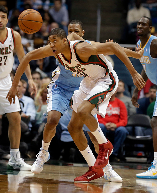 . Milwaukee Bucks\' Giannis Antetokounmpo (34) eyes a loose ball against the Denver Nuggets during the second half of an NBA basketball game Thursday, Feb. 20, 2014, in Milwaukee. (AP Photo/Jeffrey Phelps)