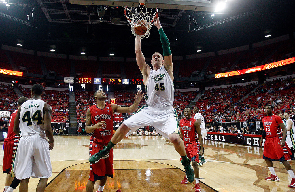 . Colorado State\'s Colton Iverson dunks during the second half of a Mountain West Conference tournament NCAA college basketball game against Fresno State on Wednesday, March 13, 2013, in Las Vegas. Colorado State defeated Fresno State 67-61. (AP Photo/Isaac Brekken)