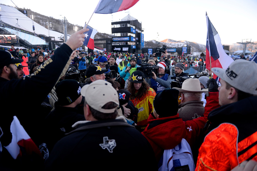 . Colten Moore (center) celebrates his late brother, Caleb, who was killed in the snowmobile freestyle event at the 2013 X Games Aspen. X Games Aspen at Buttermilk on Friday, January 25, 2014. (Photo by AAron Ontiveroz/The Denver Post)