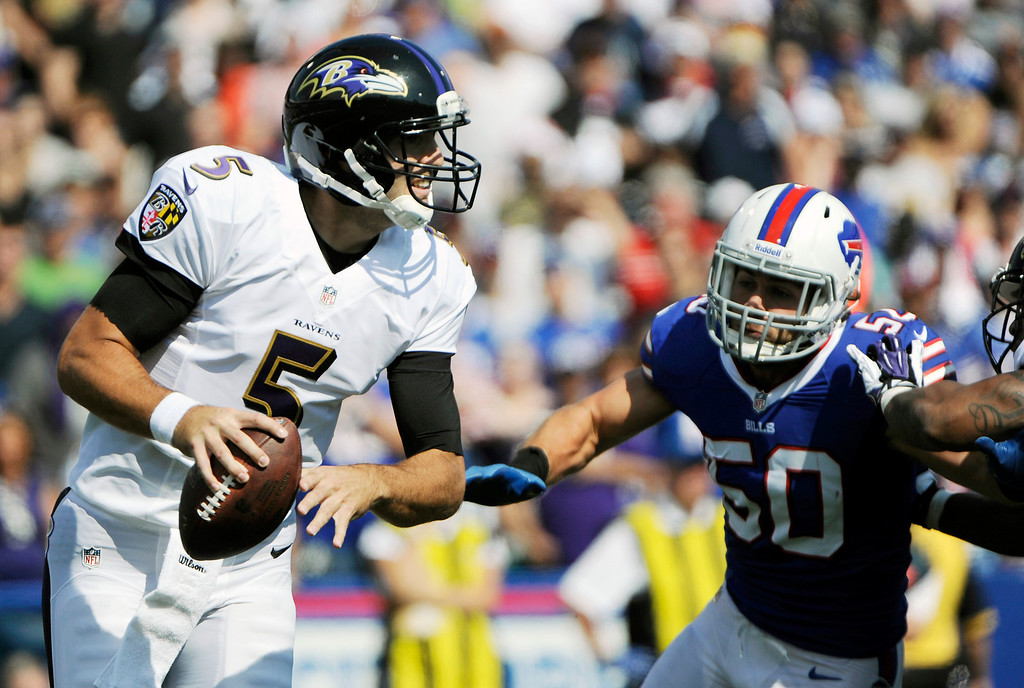 . Baltimore Ravens quarterback Joe Flacco (5) runs under pressure from Buffalo Bills middle linebacker Kiko Alonso (50) during the first half of an NFL football game on Sunday, Sept. 29, 2013, in Orchard Park, N.Y. (AP Photo/Gary Wiepert)