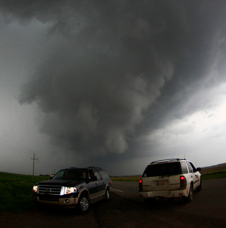 . Storm chasers get close to a tornadic thunderstorm, one of several tornadoes that touched down, in South Haven, Kansas, May 19, 2013. A massive storm front swept north through the central United States on Sunday, hammering the region with fist-sized hail, blinding rain and tornadoes, including a half-mile wide twister that struck near Oklahoma City. News reports said at least one person had died. REUTERS/Gene Blevins