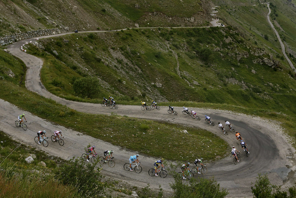 . Overall leader\'s yellow jersey Britain\'s Christopher Froome rides in the pack in the Col de Sarenne during the 172.5 km eighteenth stage of the 100th edition of the Tour de France cycling race on July 18, 2013 between Gap and Alpe-d\'Huez, French Alps.  JOEL SAGET/AFP/Getty Images