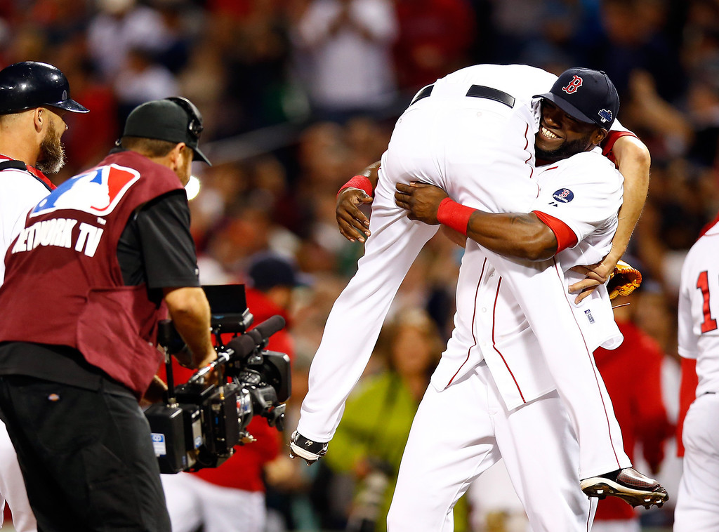 . BOSTON, MA - OCTOBER 05:  David Ortiz #34 picks up Koji Uehara #19 of the Boston Red Sox after defeating the Tampa Bay Rays 7-4 in Game Two of the American League Division Series at Fenway Park on October 5, 2013 in Boston, Massachusetts.  (Photo by Jared Wickerham/Getty Images)