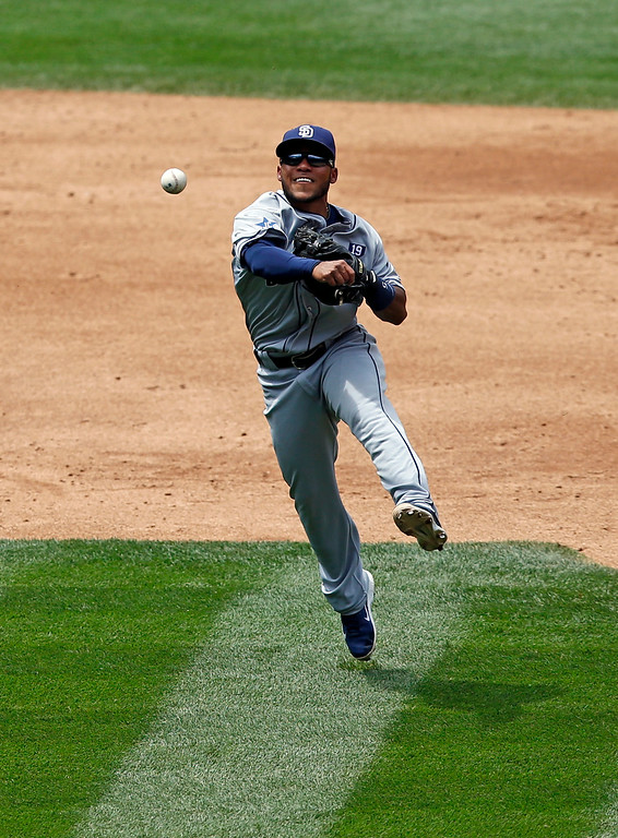 . San Diego Padres third baseman Alexi Amarista throws out Colorado Rockies\' Charlie Blackmon at first during the third inning of a baseball game on Wednesday, July 9, 2014, in Denver. (AP Photo/Jack Dempsey)