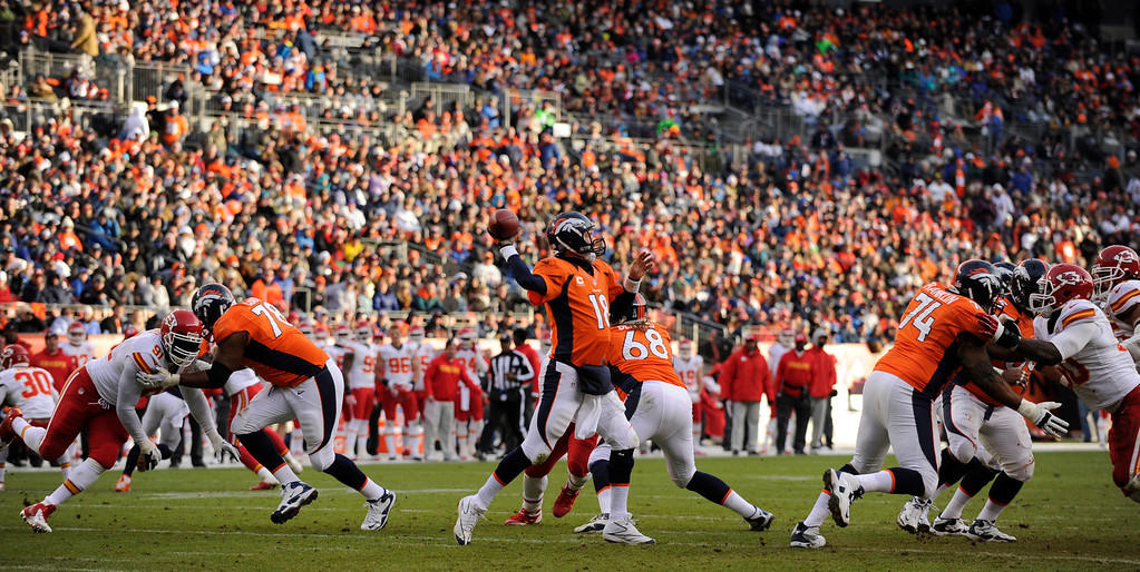 . Denver Broncos quarterback Peyton Manning (18) drops back to throw during the second quarter. The Denver Broncos vs Kansas City Chiefs at Sports Authority Field Sunday December 30, 2012. Tim Rasmussen, The Denver Post