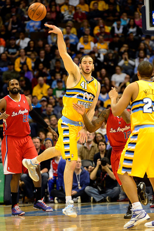 . Denver Nuggets center Kosta Koufos (41) taps a loose ball out during the second half of the Nugget\'s 89-74 win at the Pepsi Center on Tuesday, January 1, 2013. AAron Ontiveroz, The Denver Post