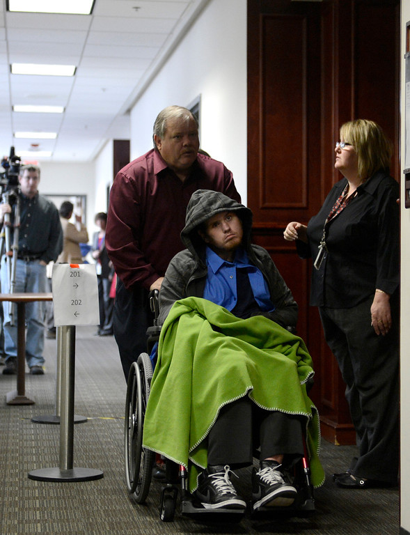 . urora theater shooting victim Caleb Medley and his father Otis Medley leave the second floor of the Arapahoe County Courthouse, Tuesday March 12, 2013 after the proceedings. District Court Judge William Sylvester entered a Not Guilty plea on behalf of Holmes. The trial begins August 5, 2013.(Photo By Joe Amon/The Denver Post)