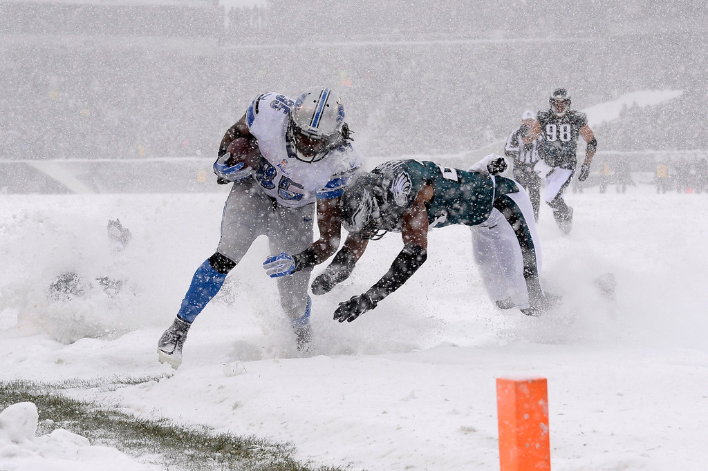 . Detroit Lions\' Joique Bell, left, is tackled by Philadelphia Eagles\' Bradley Fletcher during the first half of an NFL football game, Sunday, Dec. 8, 2013, in Philadelphia. (AP Photo/Michael Perez)