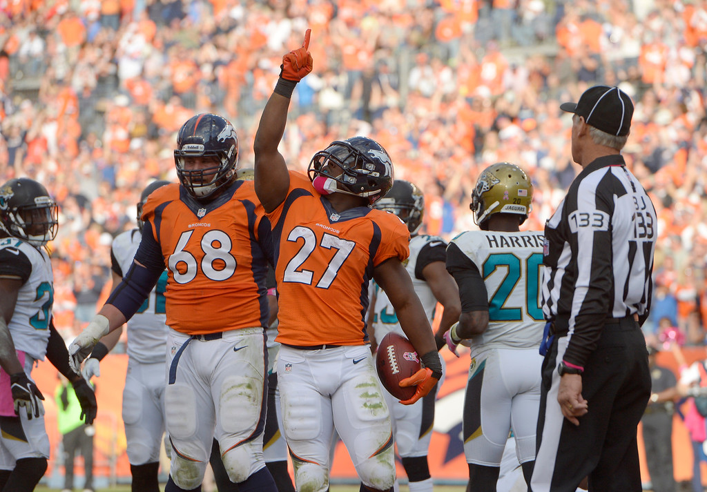 . Denver Broncos running back Knowshon Moreno (27) points to the sky after scoring in the third quarter.  (Photo by Joe Amon/The Denver Post)