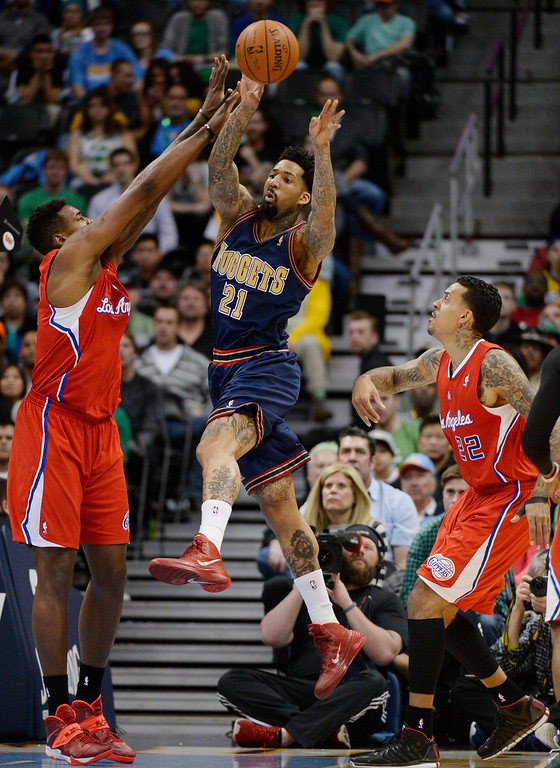 . Denver Nuggets forward Wilson Chandler (21) makes a pass as Los Angeles Clippers center DeAndre Jordan (6) defends on the play late in then fourth quarter March 17, 2014 at Pepsi Center. Denver Nuggets defeated the Los Angeles Clippers 110-100. (Photo by John Leyba/The Denver Post)