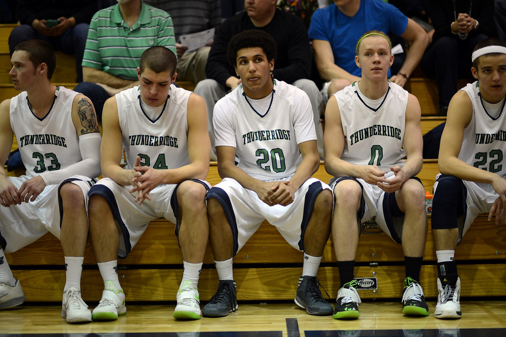 . HIGHLANDS RANCH, CO. - MARCH 02: From left,  ThunderRidge High School starters Peter Howell #33, Zach Rusk #24, Keelan Hammonds #20, Joe Marucci, #0 and Hunter O\'Neill are in the bench before the 2nd round of 5A playoff game against Overland High School at ThunderRidge High School. March 2, 2013. Highlands Ranch, Colorado. ThunderRidge won 67-57. (Photo By Hyoung Chang/The Denver Post)