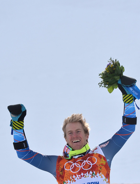 . Gold medallist US skier Ted Ligety stands on the podium during the Men\'s Alpine Skiing Giant Slalom Flower Ceremony at the Rosa Khutor Alpine Center during the Sochi Winter Olympics on February 19, 2014.   AFP PHOTO / DIMITAR DILKOFF/AFP/Getty Images