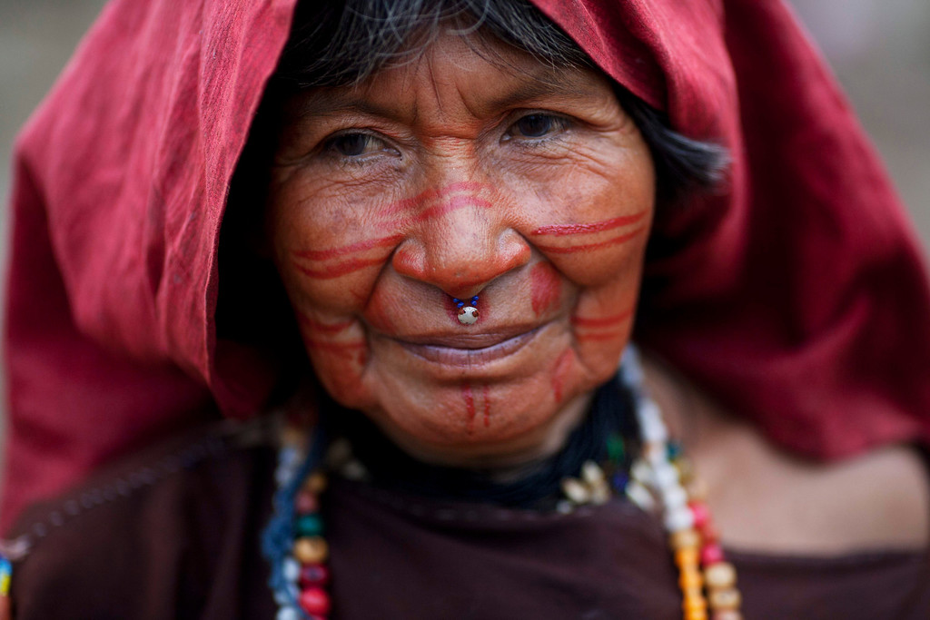 . In this Oct. 1, 2013 photo, Ashaninka Indian Antonia Ayeque stands outside her house in Kitamaronkani, Pichari district, Peru. The Ashaninka are the largest indigenous group in Peru�s sparsely populated Amazon region but still account for less than 1 percent of the South American country�s 30 million people. The people subsist largely on manioc, a diet they supplement with fish and wild rodents known as pacas. (AP Photo/Rodrigo Abd)