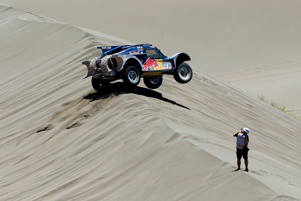 . Buggy driver Carlos Sainz of Spain and co-pilot Timo Gottschalk of Germany race in the dunes during the second stage of the Dakar Rally between the cities of San Luis and San Rafael in San Rafael, Argentina, Monday  Jan. 6, 2014. This is the sixth consecutive year the race has been run in South America, and the first time Bolivia has been on the route. (AP Photo/Victor R. Caivano)