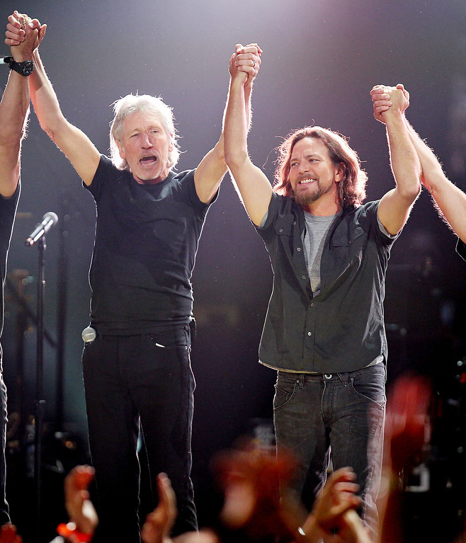 . This image released by Starpix shows Roger Waters, left, and Eddie Vedder at the 12-12-12 The Concert for Sandy Relief at Madison Square Garden in New York on Wednesday, Dec. 12, 2012. Proceeds from the show will be distributed through the Robin Hood Foundation. (AP Photo/Starpix, Dave Allocca)