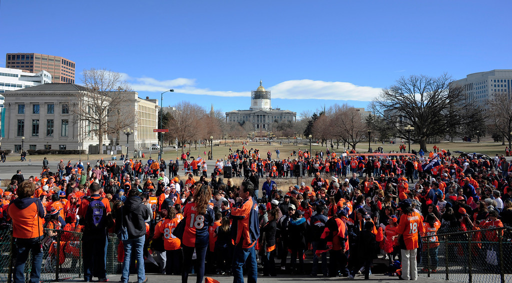 . Fans assemble during a rally to send off the Denver Broncos, at the City and County Building in Denver, Colorado, Sunday, January 26, 2014. The noon rally brought out scores of supporters and included an appearance by Governor John Hickenlooper and Denver Mayor Michael Hancock.  (Photo By Brenden Neville / Special to The Denver Post)