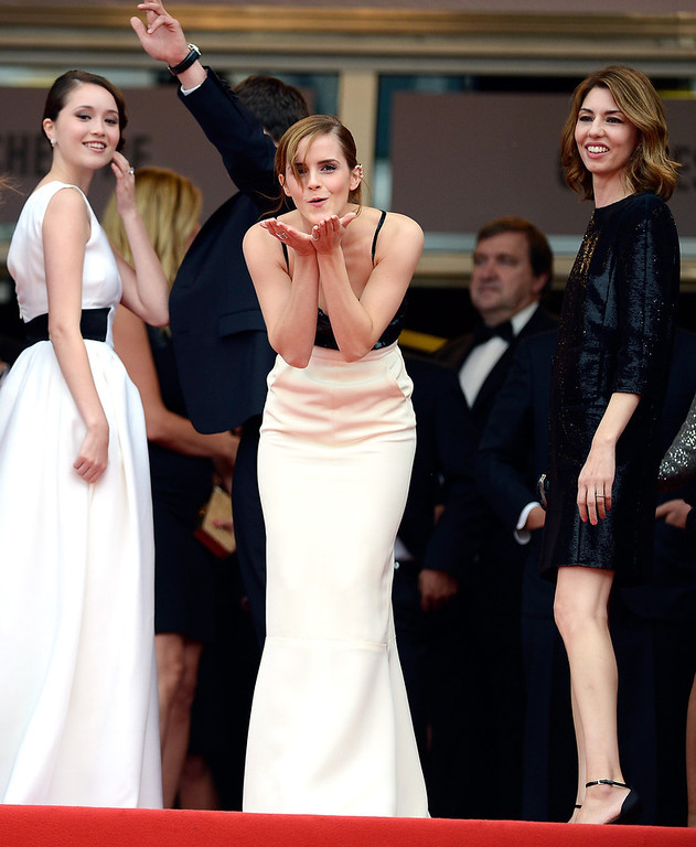 . Actress Emma Watson blows a kiss as Katie Chang (L) and Sophia Coppola look on prior to \'The Bling Ring\' premiere during The 66th Annual Cannes Film Festival at the Palais des Festivals on May 16, 2013 in Cannes, France.  (Photo by Pascal Le Segretain/Getty Images)