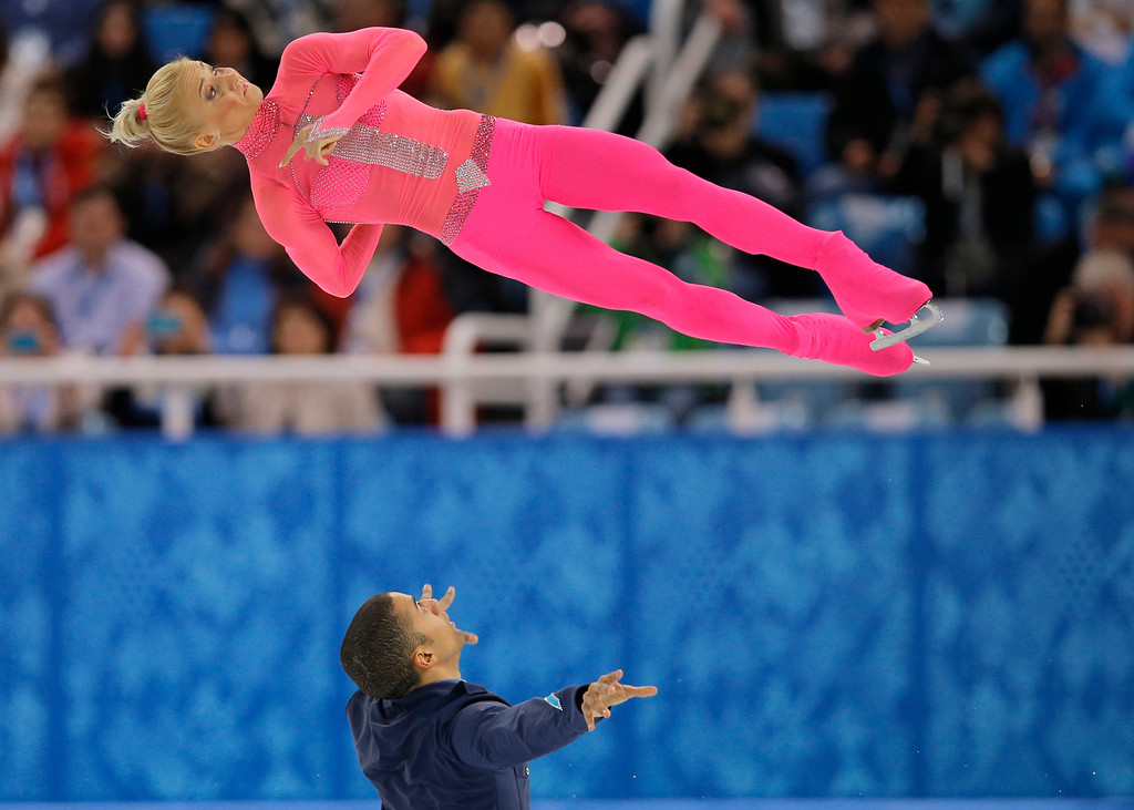 Description of . Aliona Savchenko and Robin Szolkowy of Germany compete in the pairs short program figure skating competition at the Iceberg Skating Palace during the 2014 Winter Olympics, Tuesday, Feb. 11, 2014, in Sochi, Russia. (AP Photo/Vadim Ghirda)