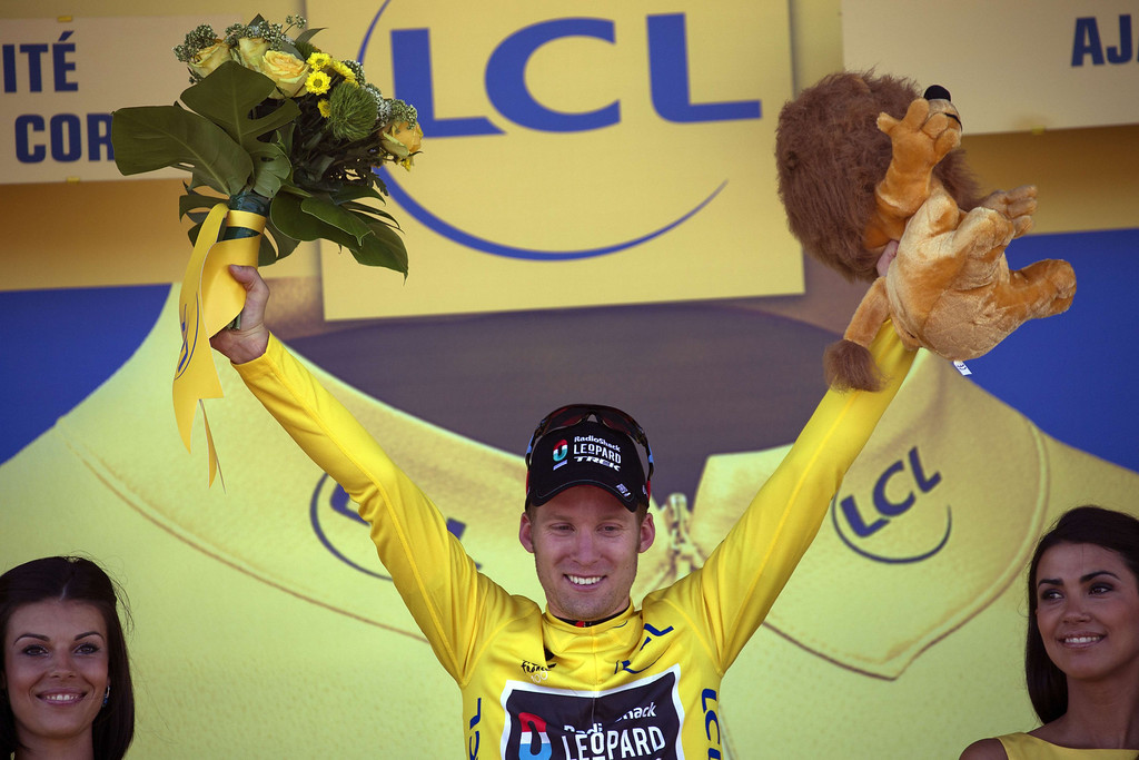 . Stage winner Belgium\'s Jan Bakelants celebrates his overall leader yellow jersey on the podium at the end of the 156 km second stage of the 100th edition of the Tour de France cycling race on June 30, 2013 between Bastia and Ajaccio, on the French Mediterranean Island of Corsica.    JEFF PACHOUD/AFP/Getty Images